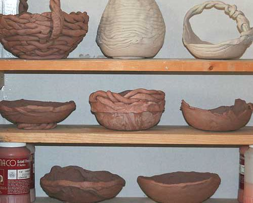 Pottery drying on shelves, showing placement for good air circulation.