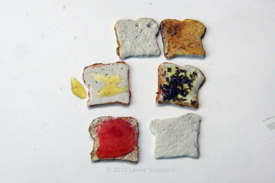 Selection of different finishes for dolls house scale miniature bread slices, and toast.