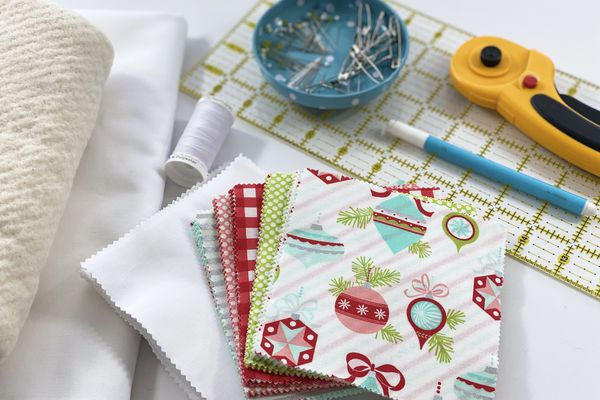 Christmas fabric and notions laying on a table