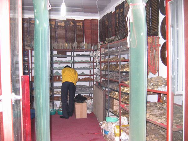 Counterfeit coins and artifacts made by a major Chinese fake coin operation await sale in one of their many storage rooms.