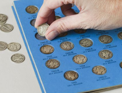 Planing coin in coin collection book