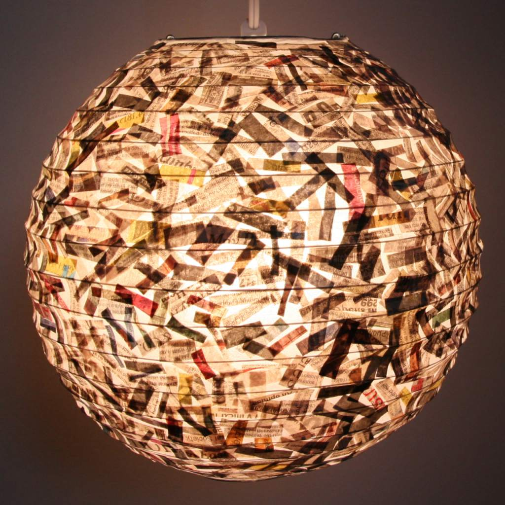 lantern decorated with newspaper pieces