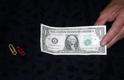Paper clips and dollar bill