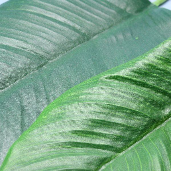 Textured fabric plant leaves up-close