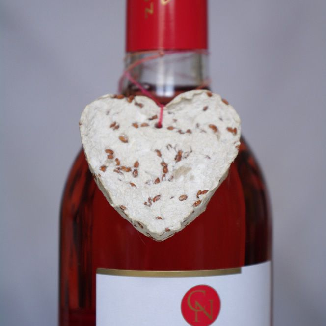 handmade plantable seed paper gift tag on a bottle of wine