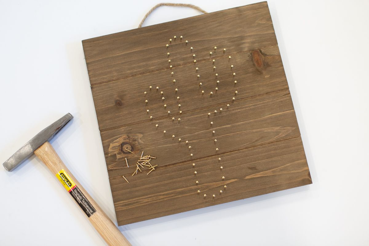 Adding Nails to Create Cute Cactus String Art