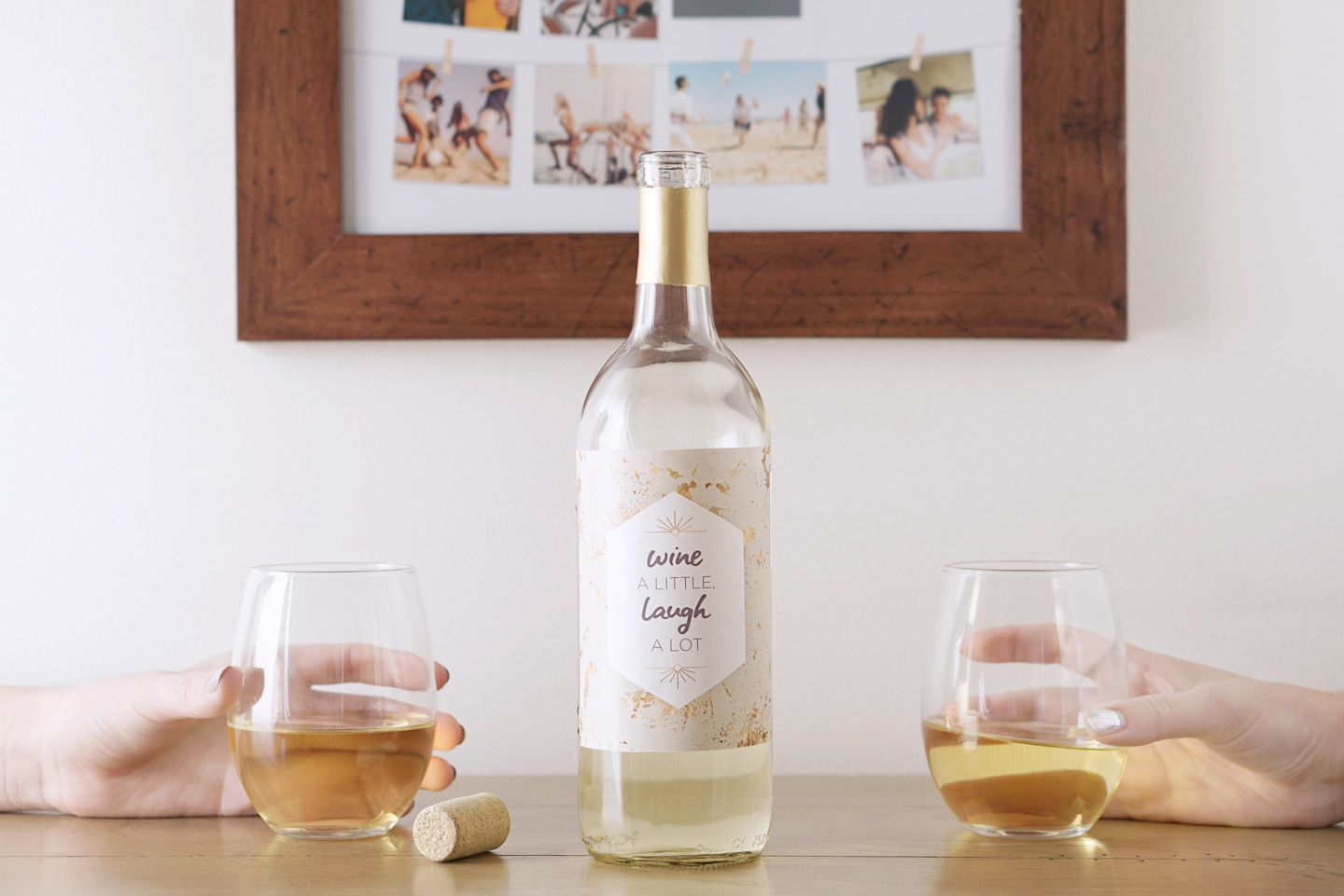 A bottle of white wine on a table with a custom label