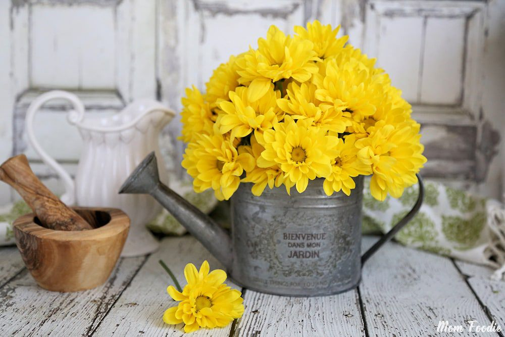 watering can flower arrangement