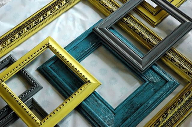 Numerous picture frames lying on a mat