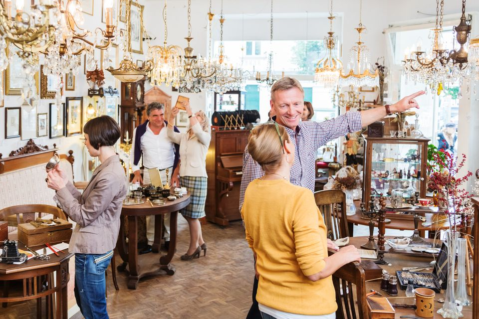 People shopping in an antique shop