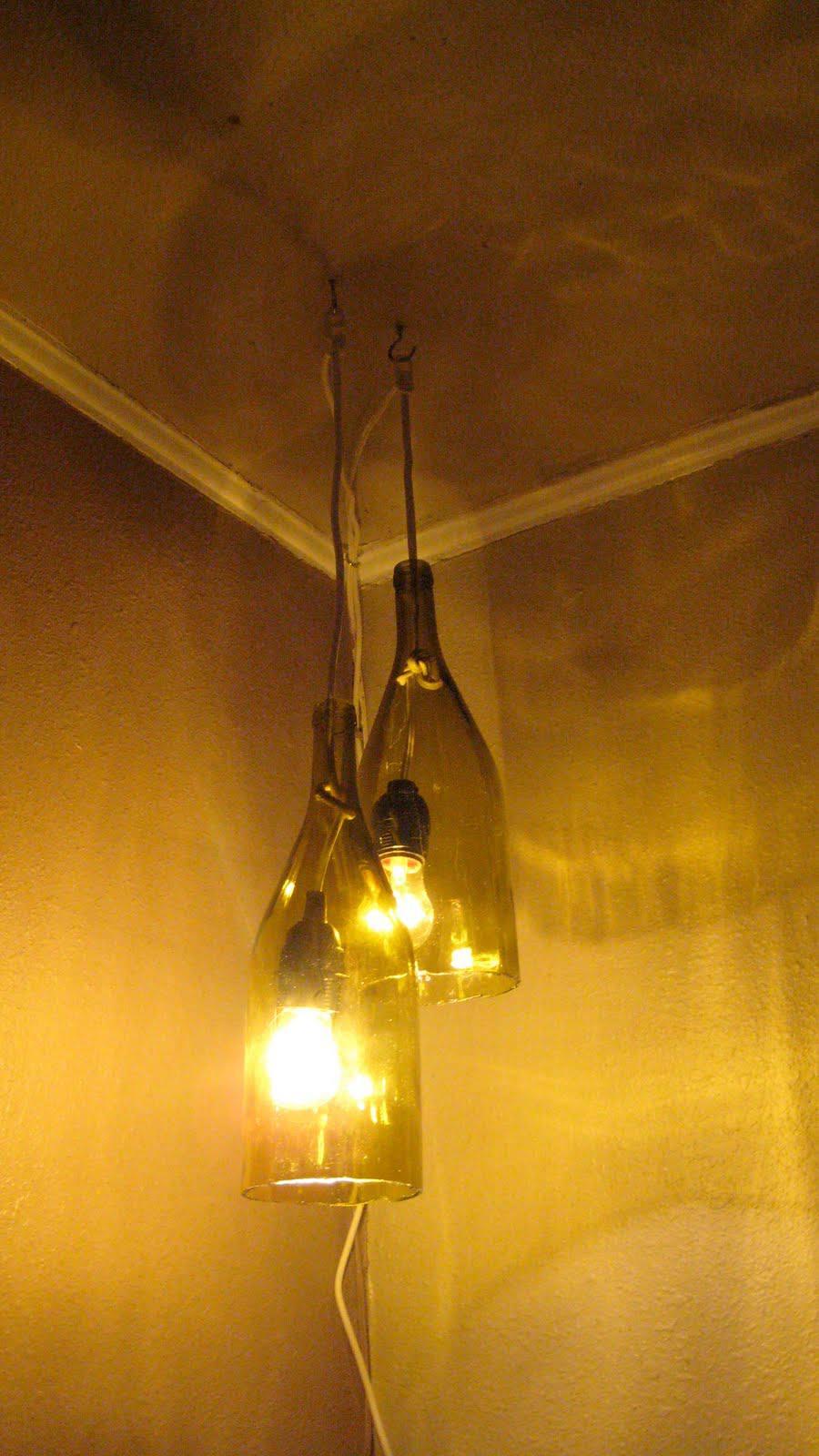 12 diy pendant light fixtures from upcycled items diy wine bottle pendant light aloadofball Choice Image