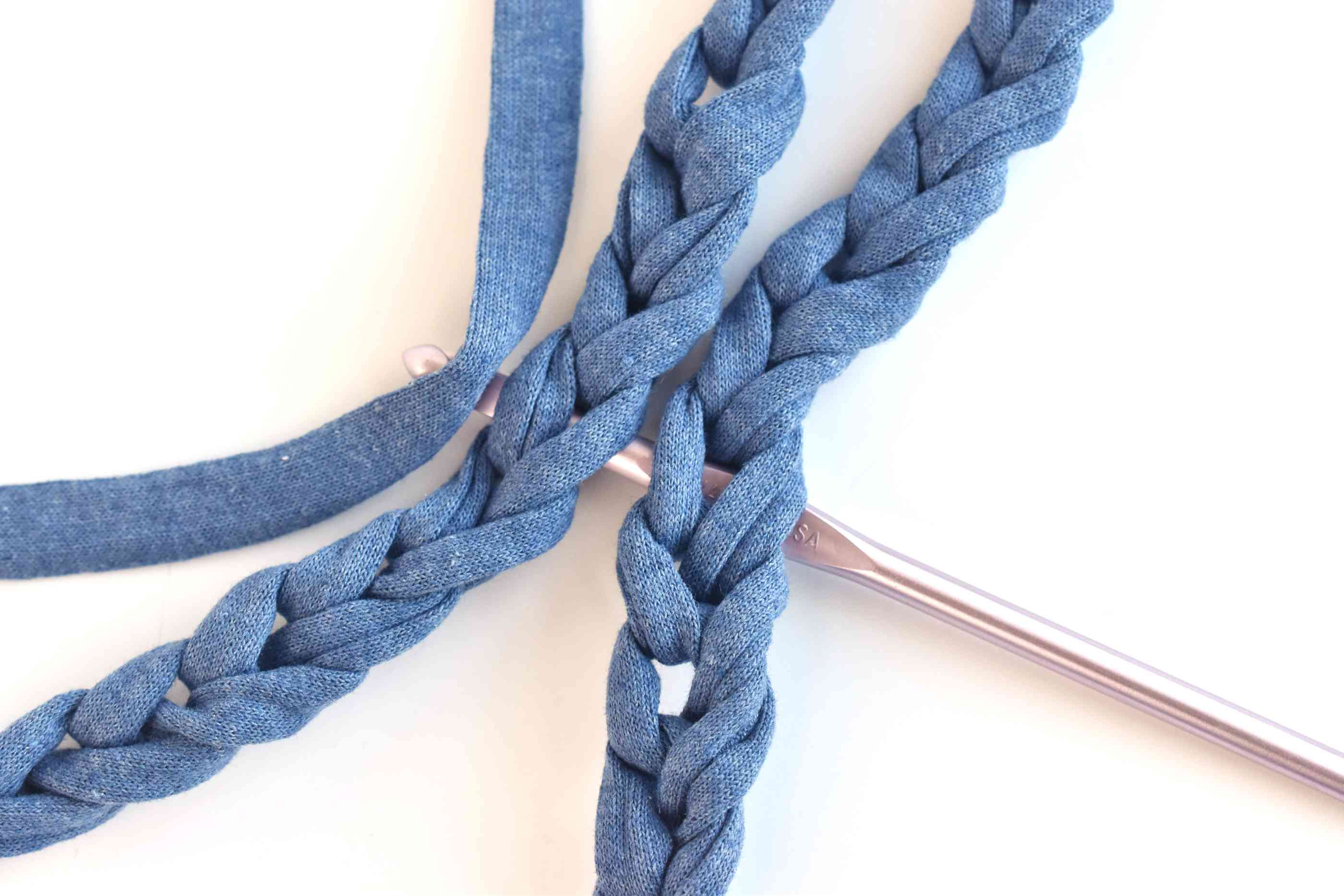 Draw a Piece of Yarn Through the Chain Hangers