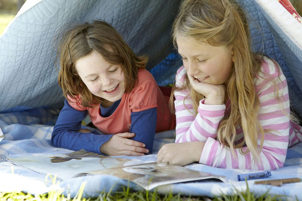 Two Girls Looking at a Book Together