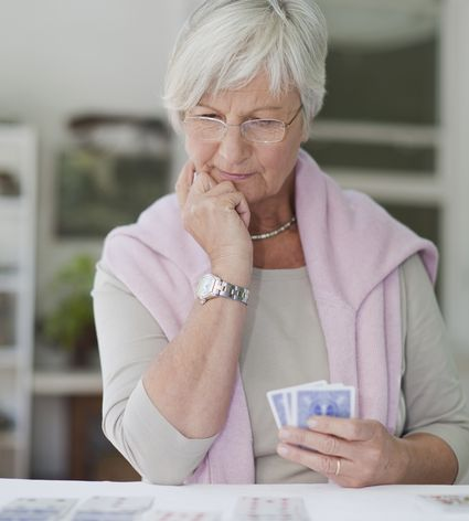 woman looking at her playing cards