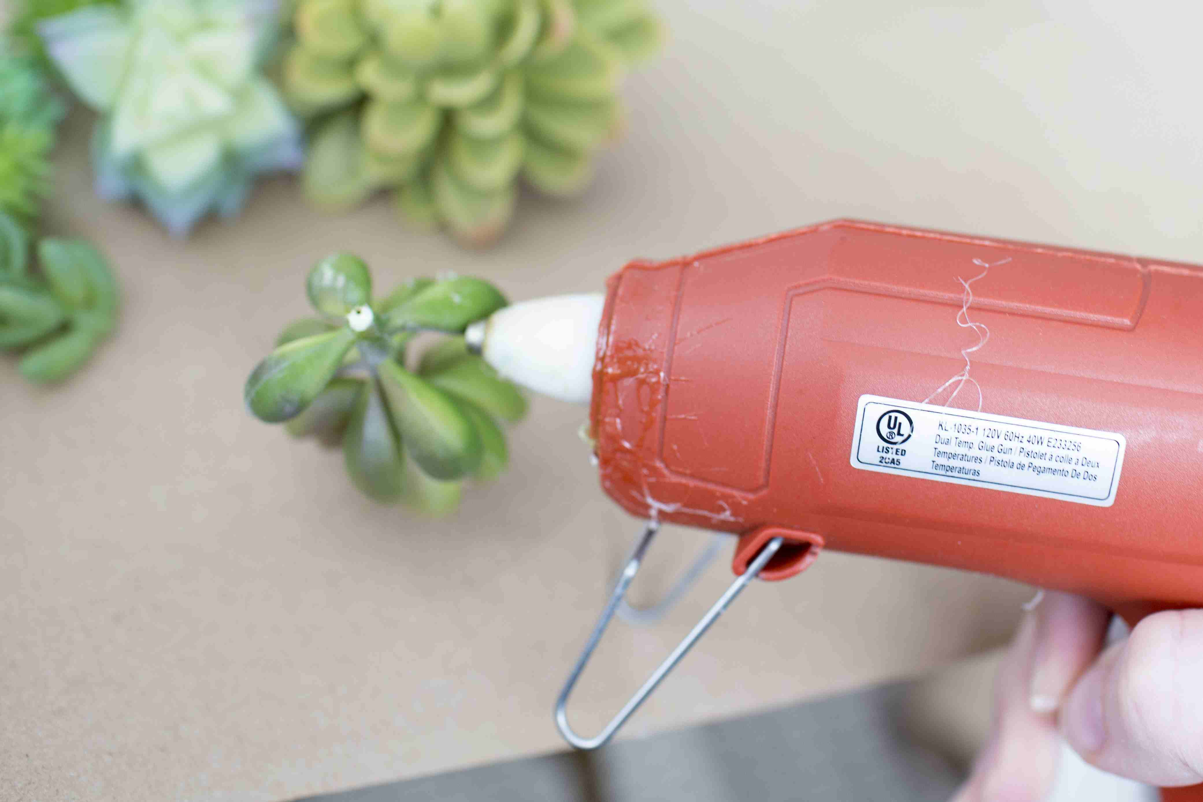 Hot glue your faux plants into their boxes