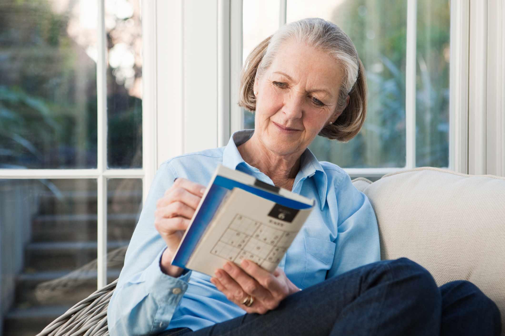 Senior woman doing sudoku puzzles