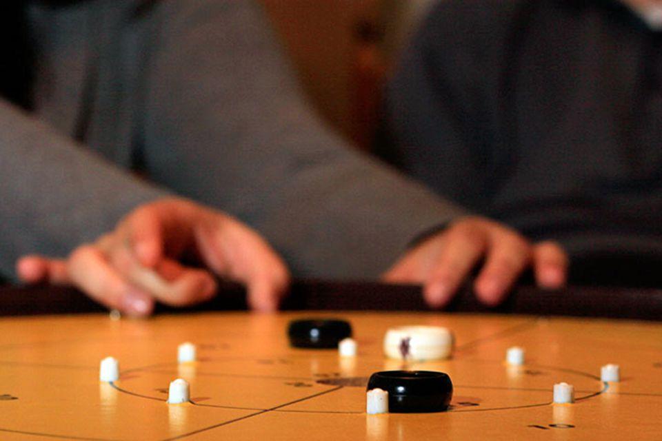 People playing Crokinole