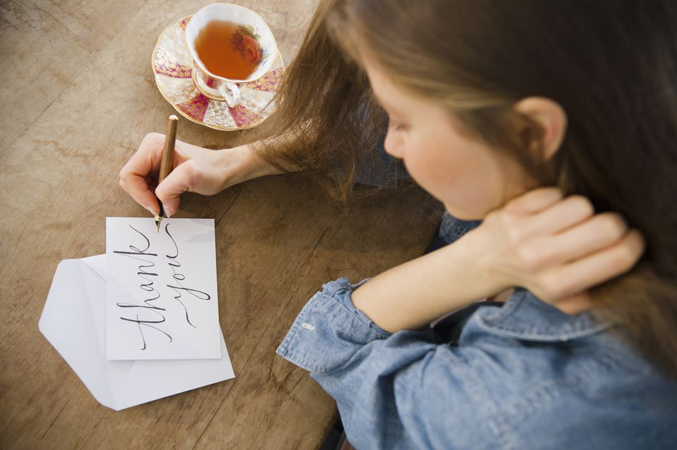 Woman writing greeting card