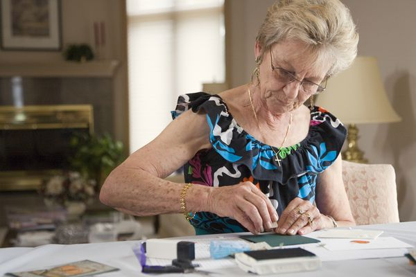 senior woman handmaking cards