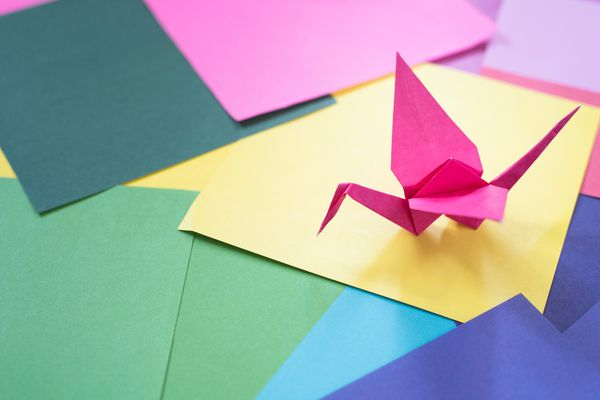 High Angle View Of Origami On Colorful Papers