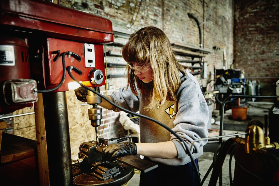 Woman using a drill press