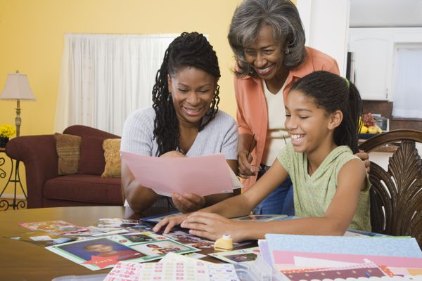 Family making scrapbook together