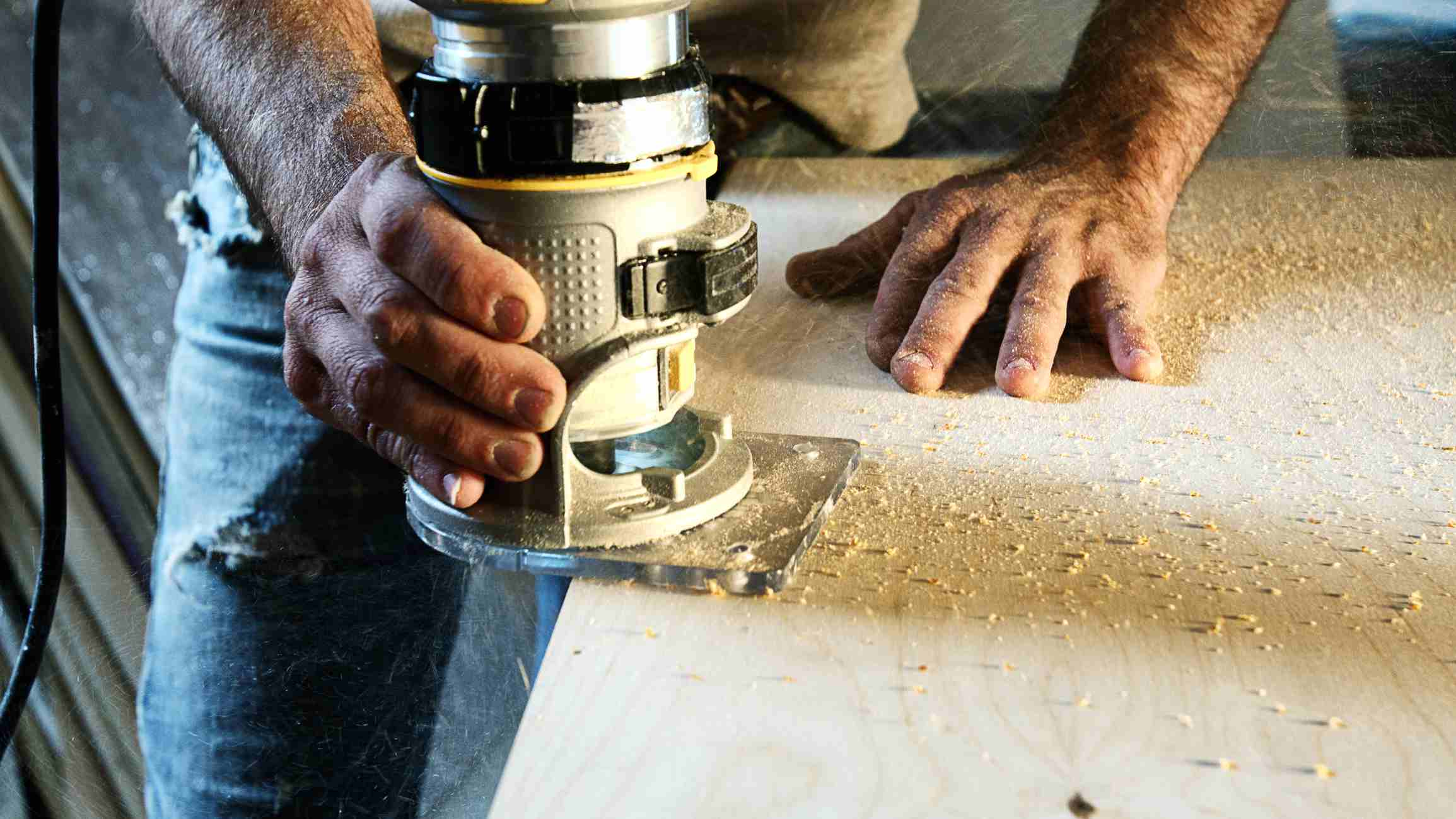 Carpenter using a wood router