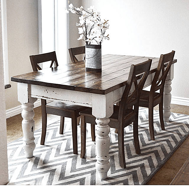 A Wide Farmhouse Table With Flowers