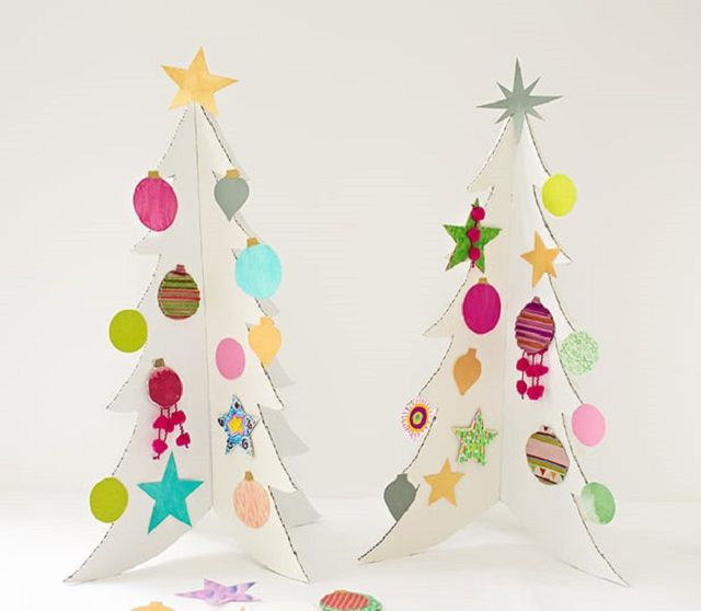 White cardboard Christmas trees with colorful ornaments glued on.