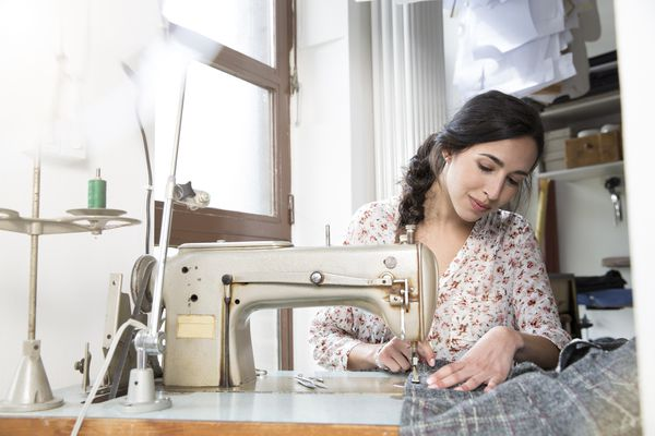 Seamstress with sewing machine