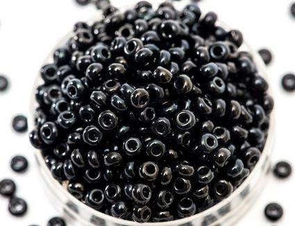 Black seed beeds in a jar