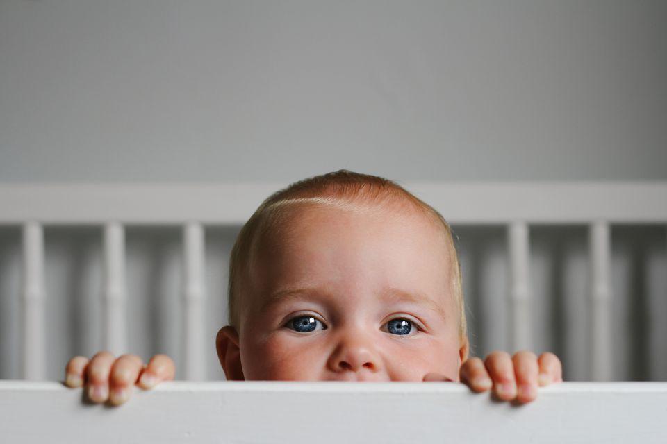 Baby Peering Over Crib