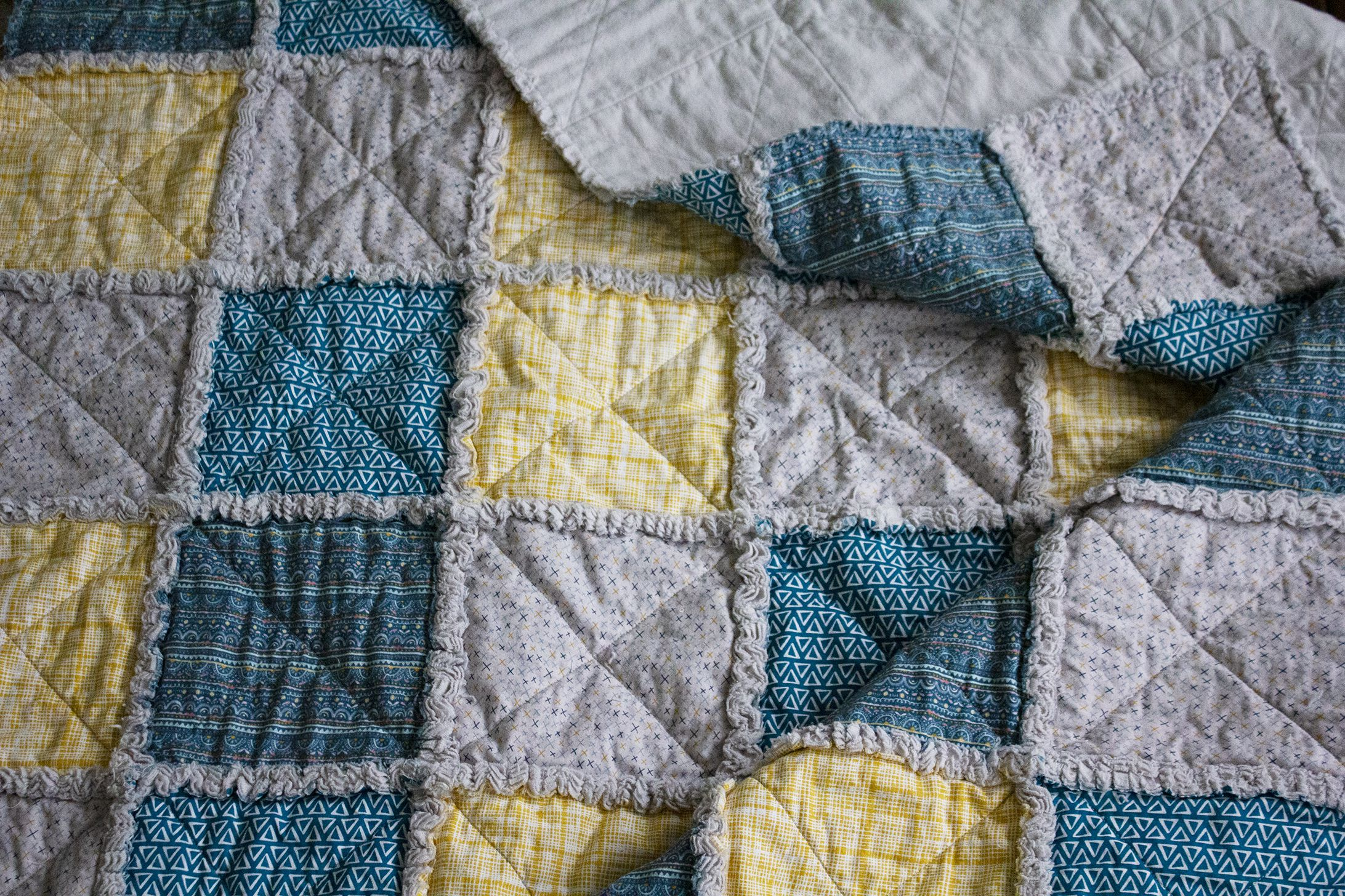 A close-up of the rag quilt after washing