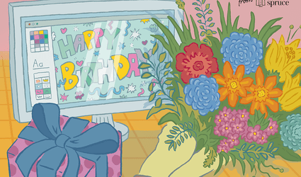 Flowers in front of a computer screen that says happy birthday