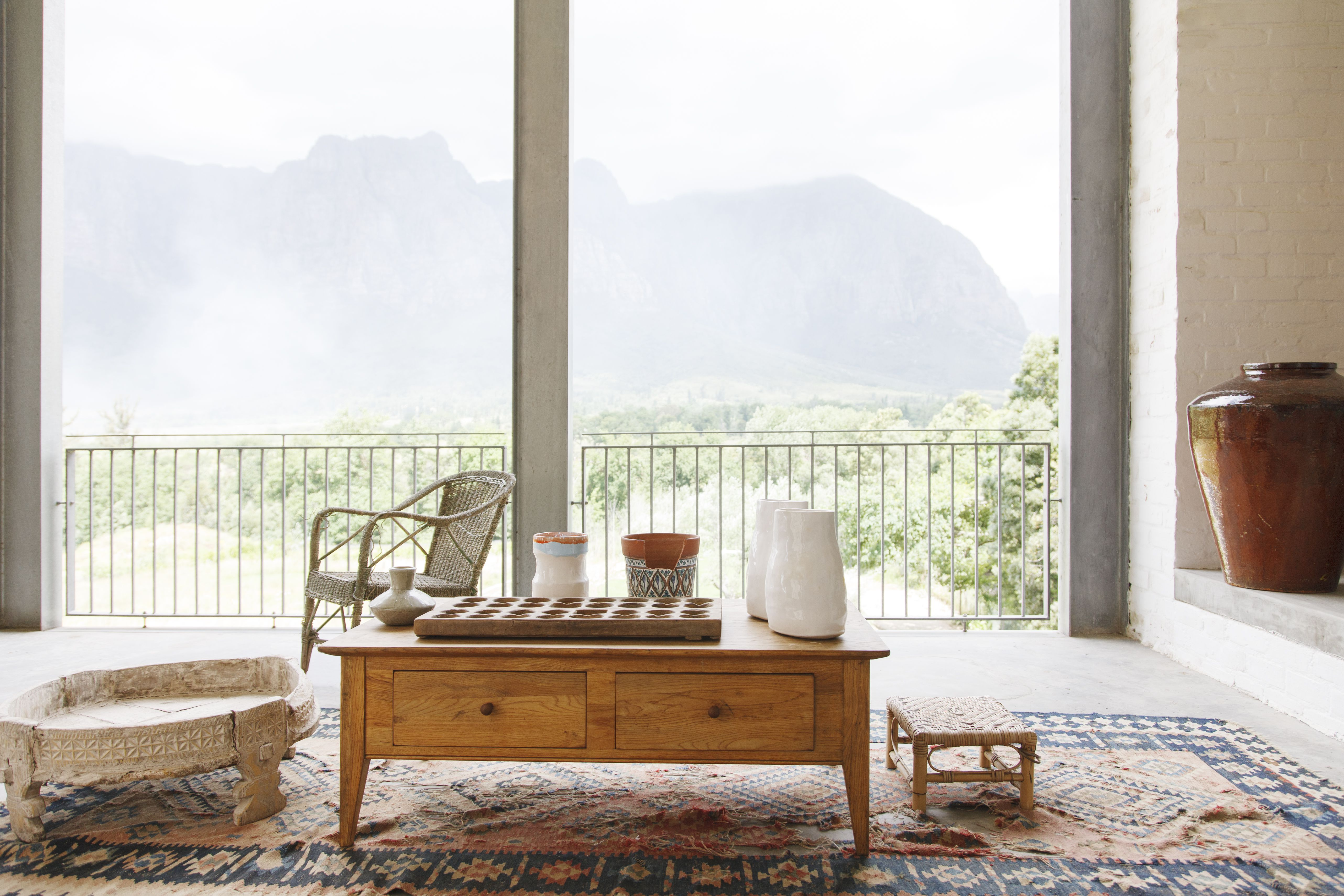 Coffee table in living room overlooking landscape