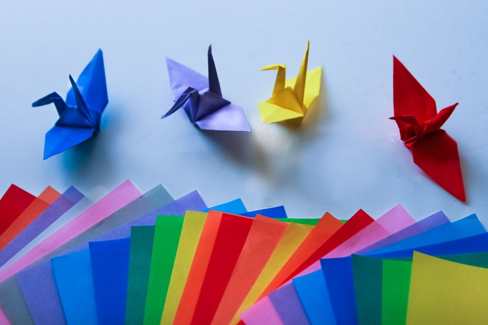A set of multi-color cranes and multi-color pages