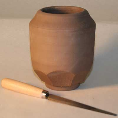 Pottery form enhanced by facet cuts