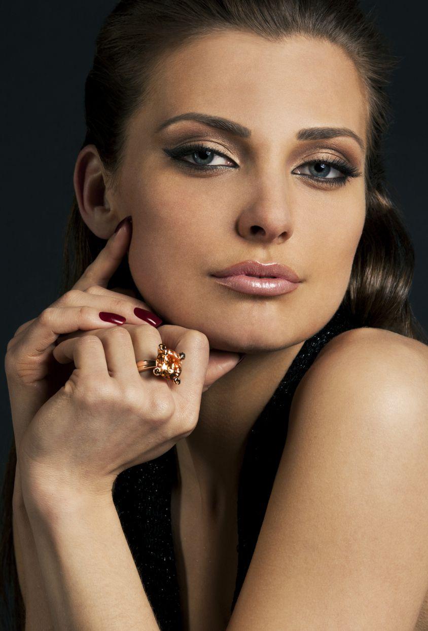 Model wearing a topaz ring