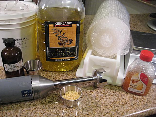 setup and ingredients for soap with beeswax and honey