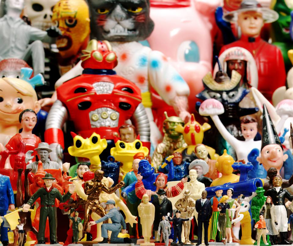 Clean retro action figures lined up in a display