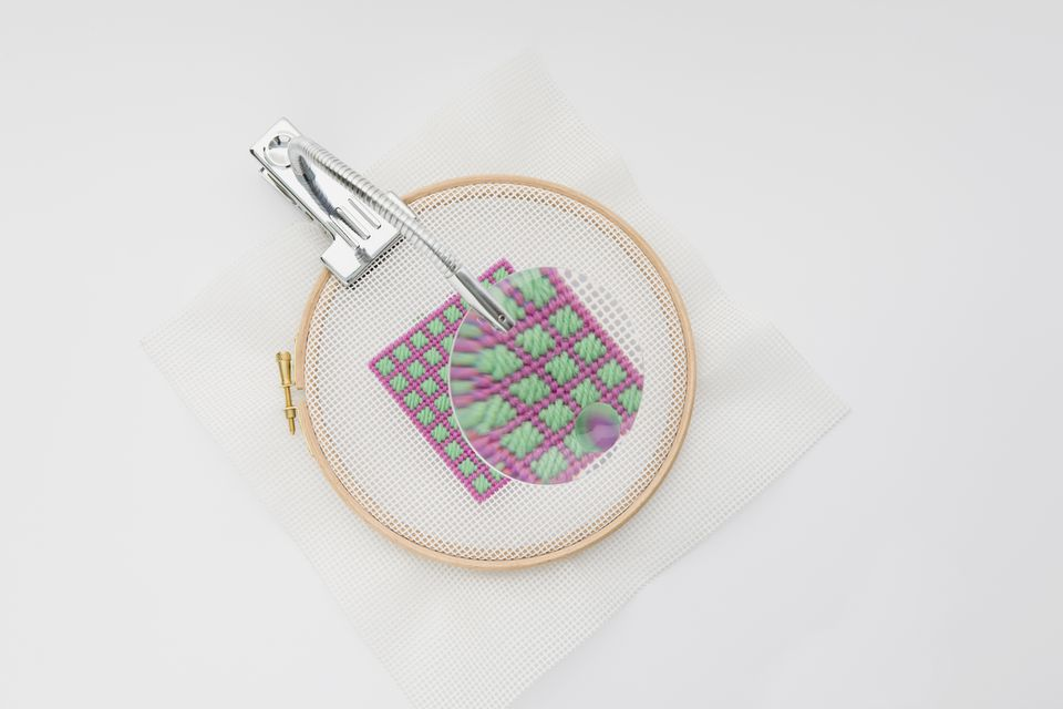 cross stitch with magnifying glass