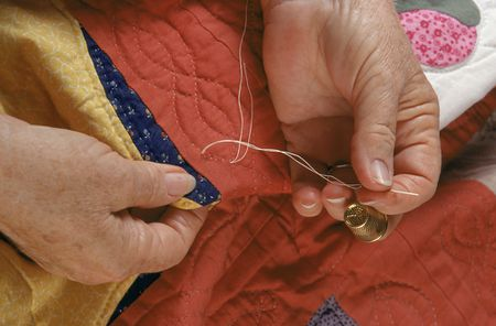 Use A Quilters Knot To Secure Hand Quilting Stitches