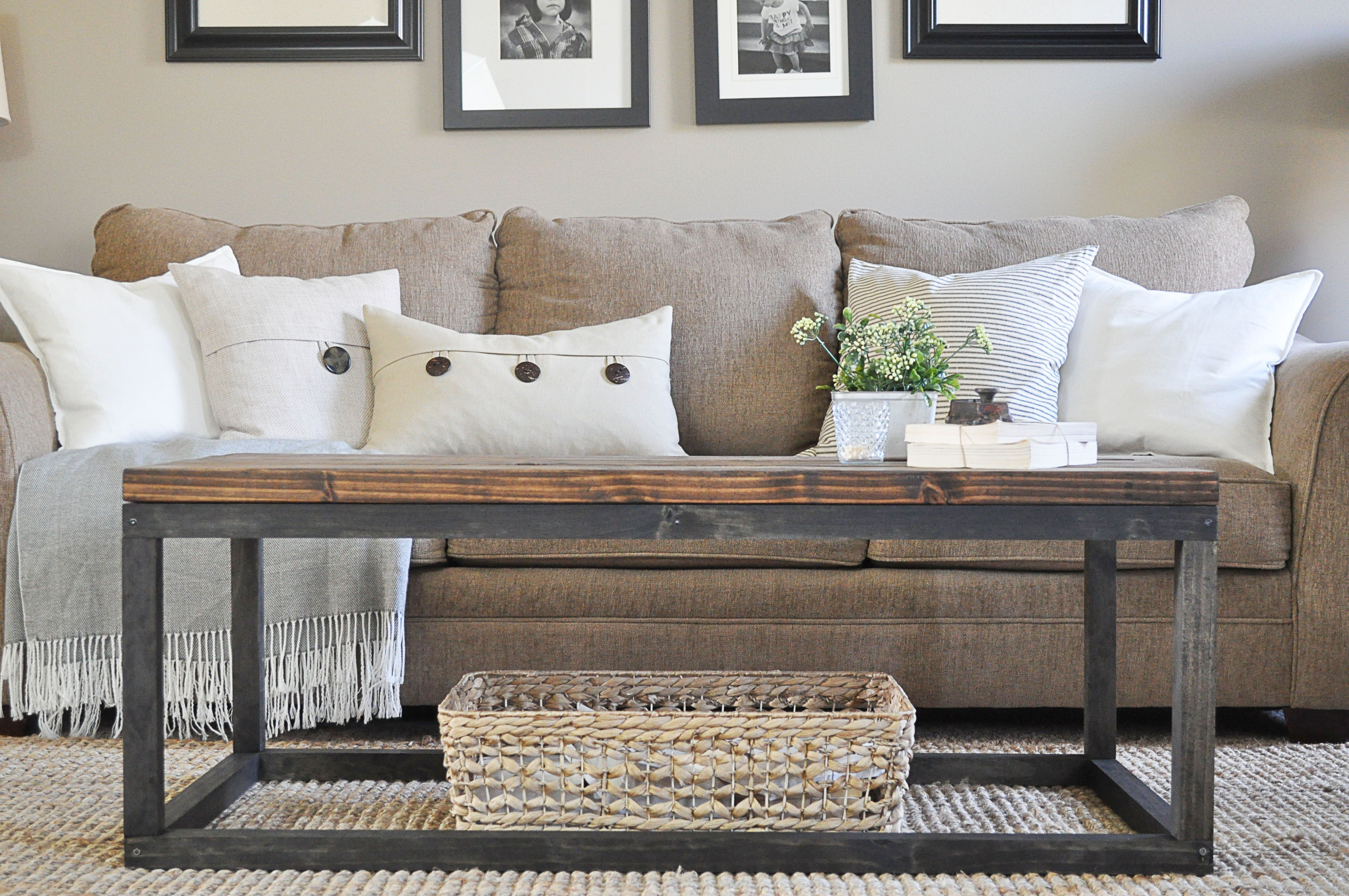 A wooden and metal coffee table in a living room