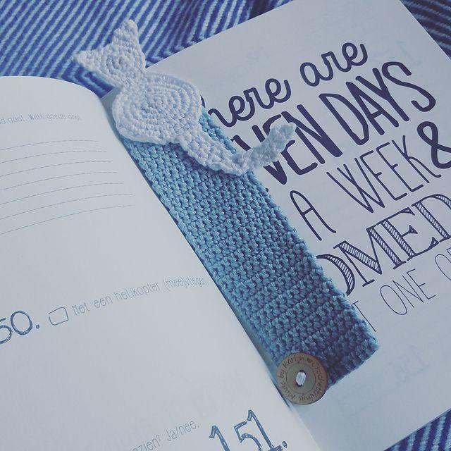 Cat crochet bookmark in a book