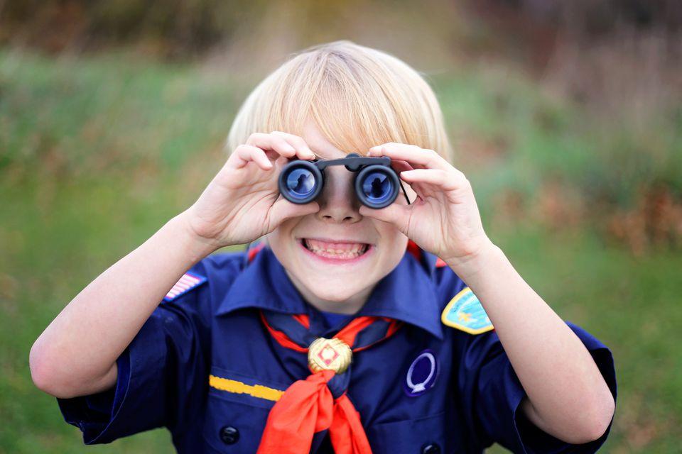 Cub scout using binoculars