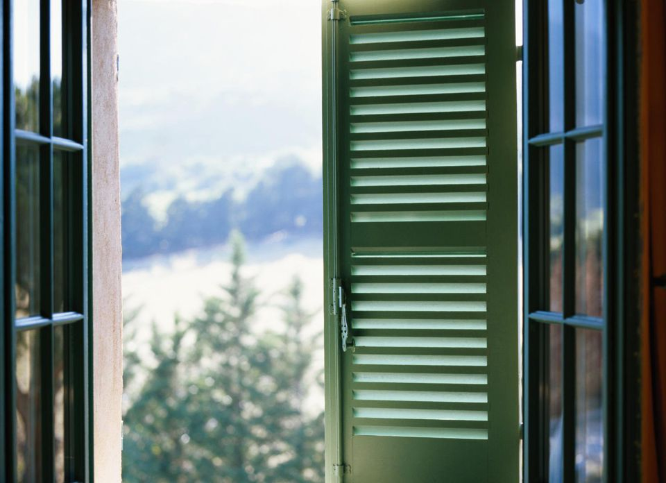 View of the mountains through louvered windows