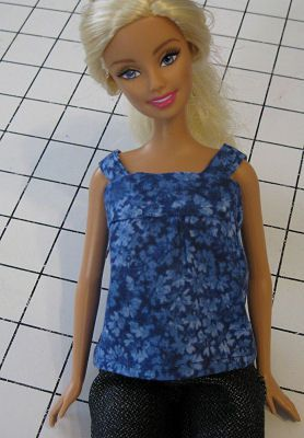Barbie wearing the blouse made from this free Barbie shirt pattern