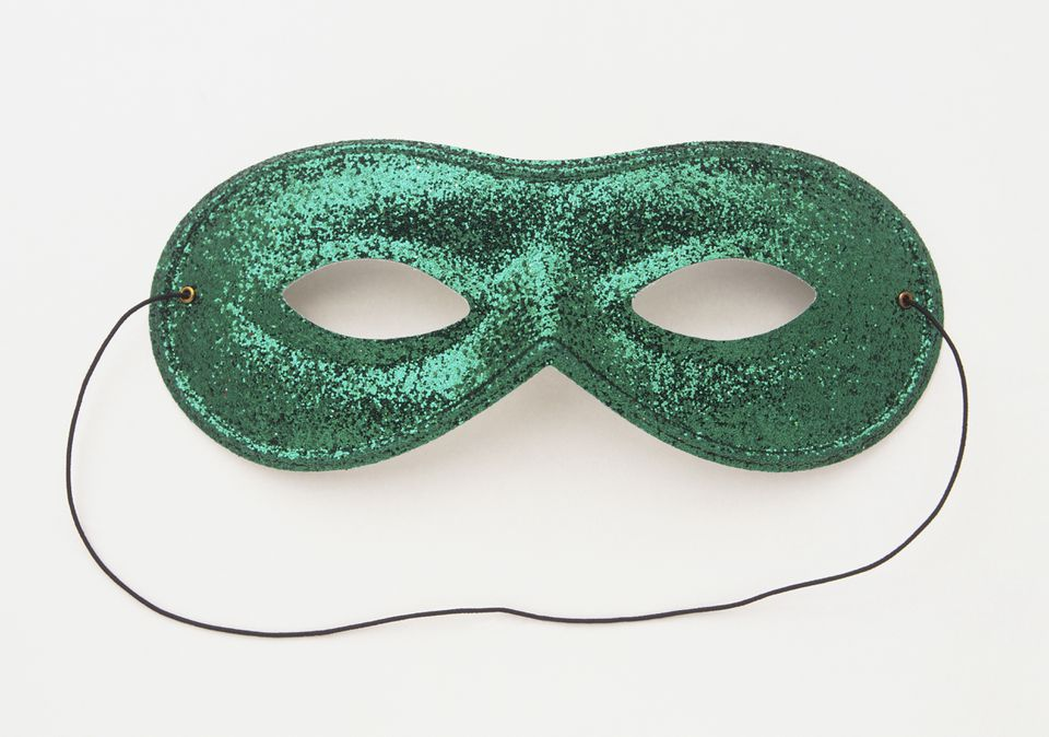 Sparkly green carnival mask with black elastic