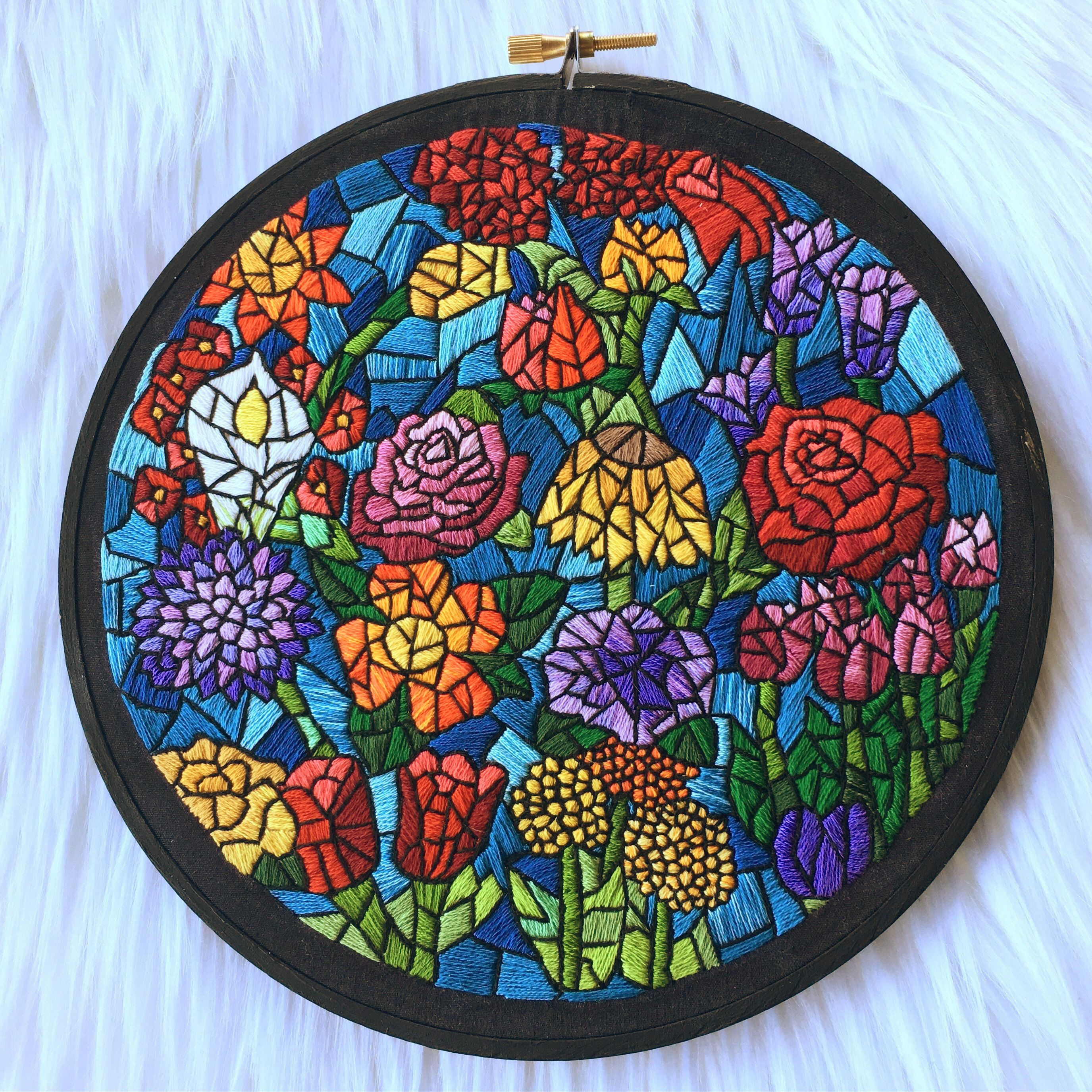 Floral stained glass embroidery pattern in an embroidery hoop.