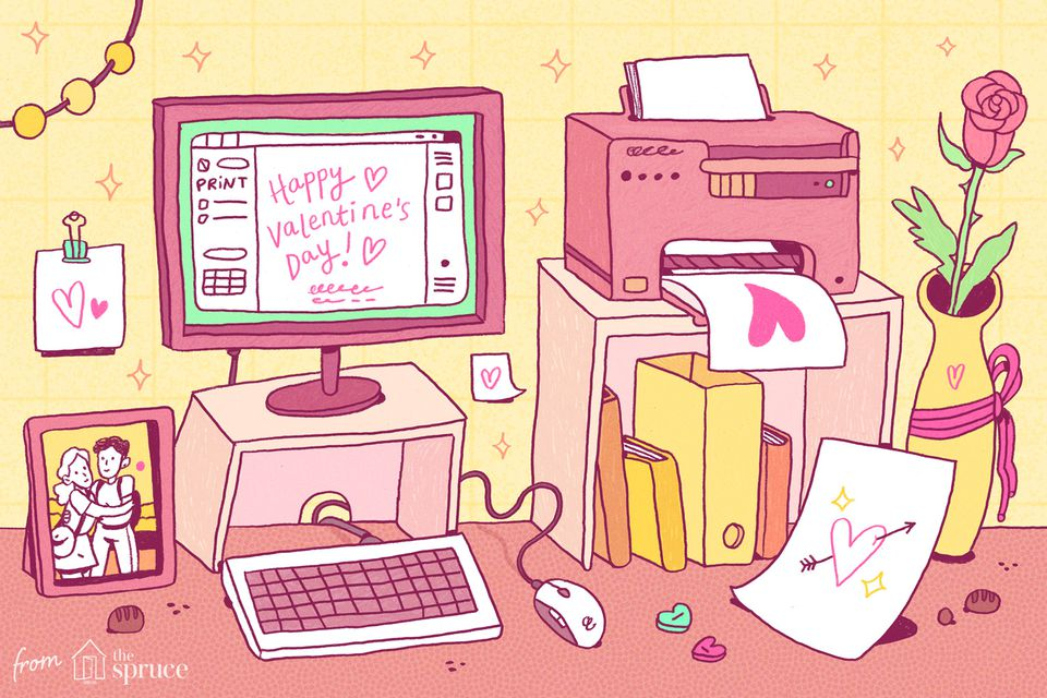 A computer screen and printer with valentines